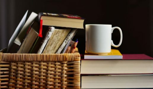 ways to empower yourself reading book pile of books with a cup of tea