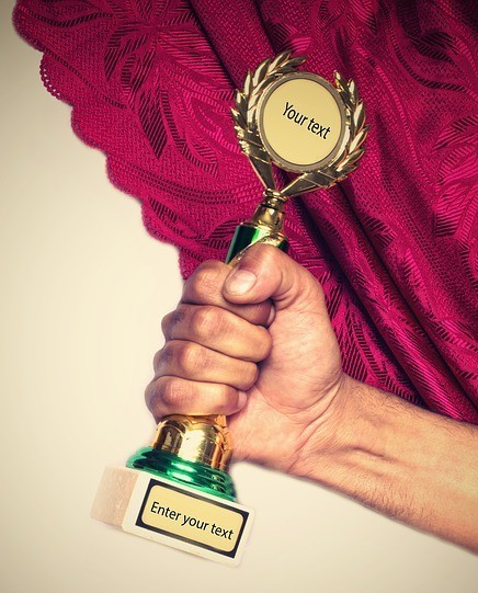 3 Simple Steps To Keep Your Employees As Employees receiving an award