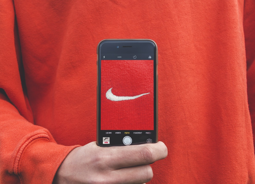 nike logo on red teeshirt showing through iphone