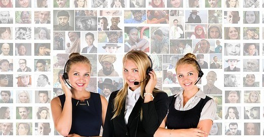three customer service reps with headsets