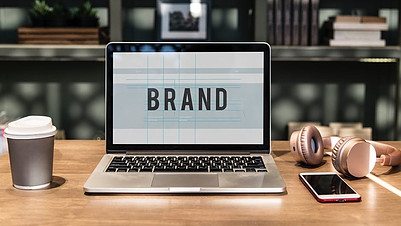 laptop with the word brand on screen how to create a brand identity for your business