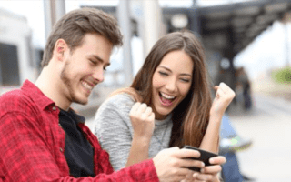 newsontop17 review couple smiling with an iphone