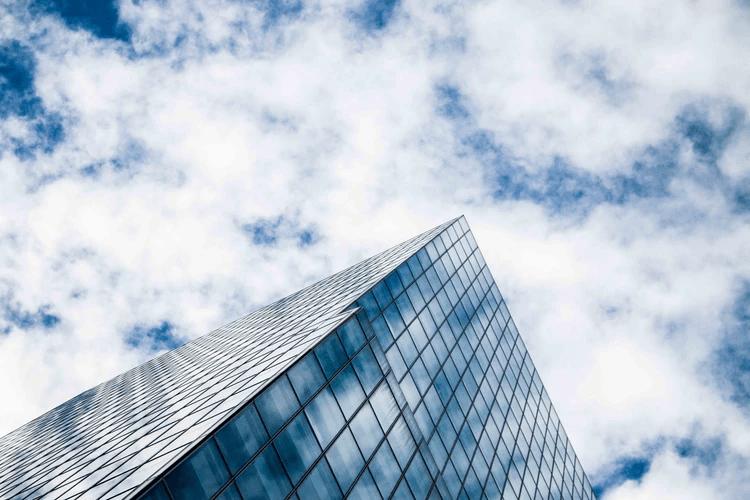 skyscraper against blue skies