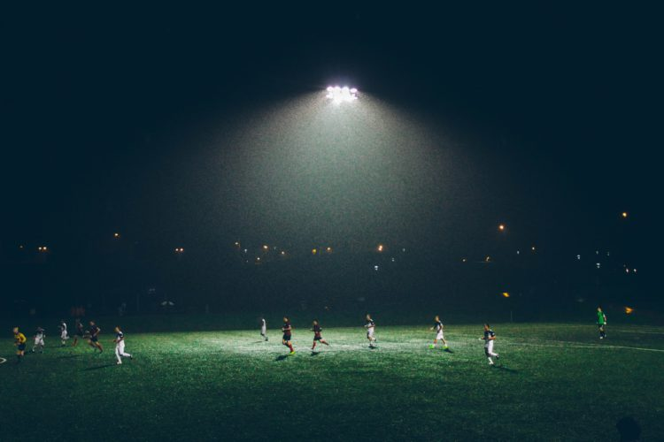 football players on a field at night
