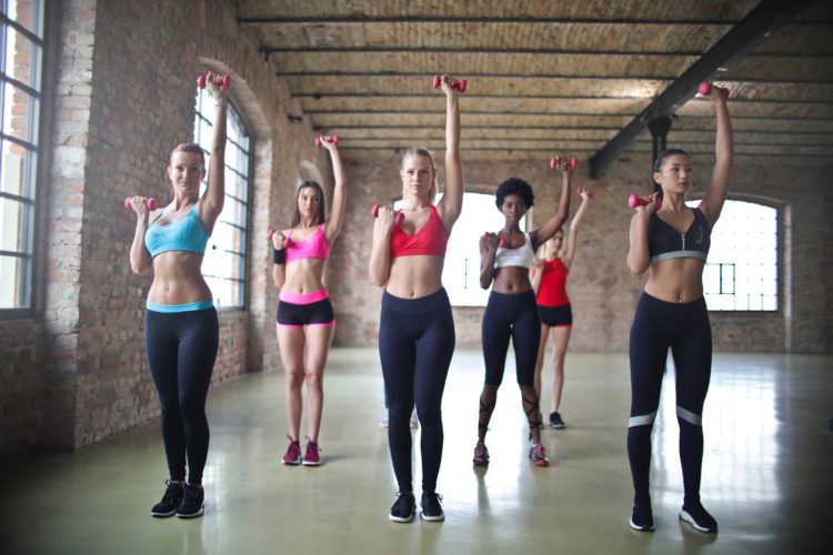 look after your health women in gym workout