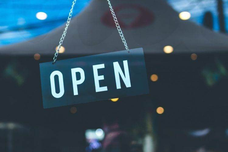 open sign in store window