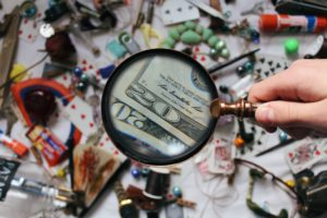 magnifying glass over $20 bill how to plan a budget