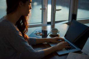 woman typing laptop work-at-home moms