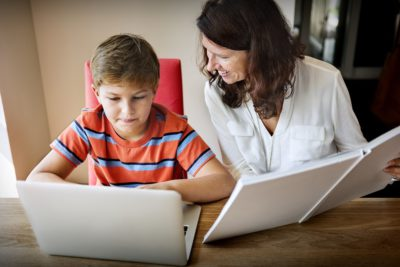mother and son on laptop home-schooled children