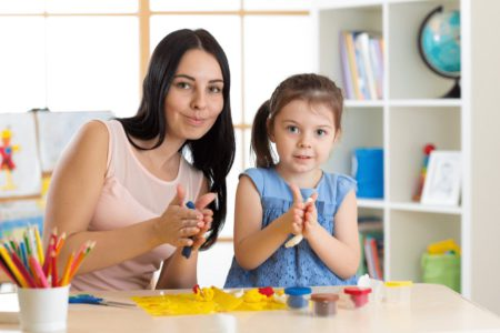 mother and daughter working with play dough