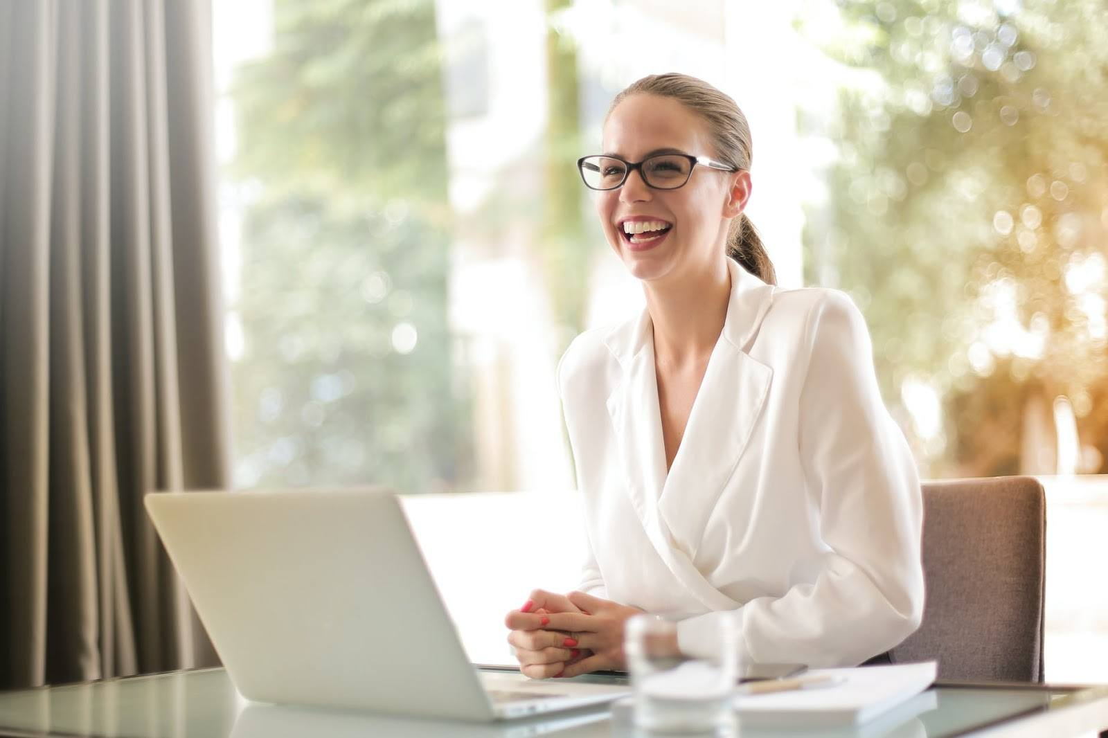laughing-businesswoman-working-in-office-with-laptop finding a meaningful career