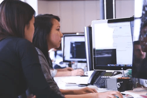 working-woman-technology-computer types of software for business