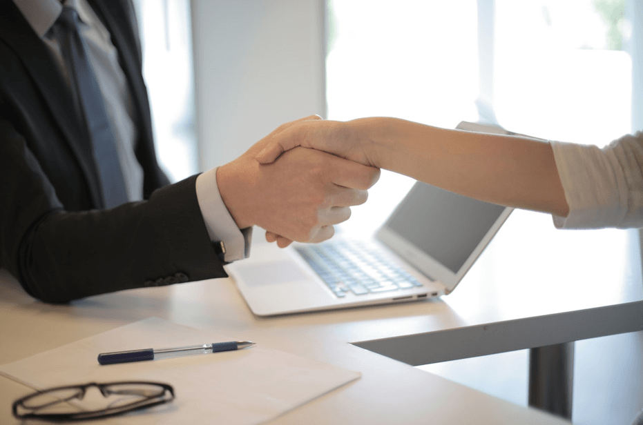 man shaking hand employee selection criteria got accepted job