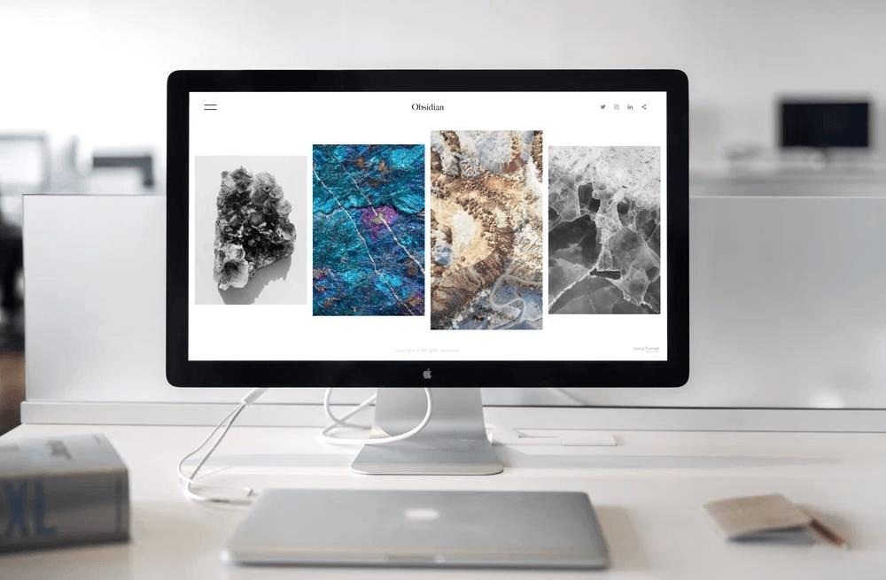 photo-of-imac-near-macbook-web design trends on screen