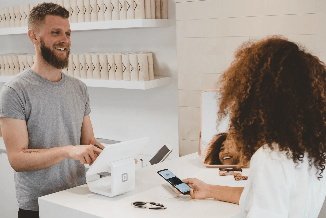 how to attract new customers customer at store making payment