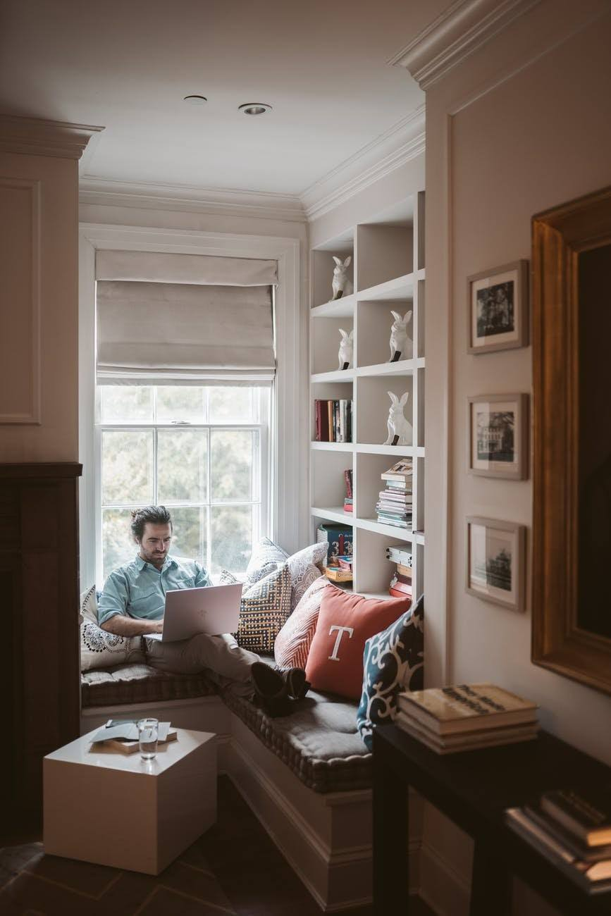 man-using-a-laptop-at-home sitting in a healthier home office