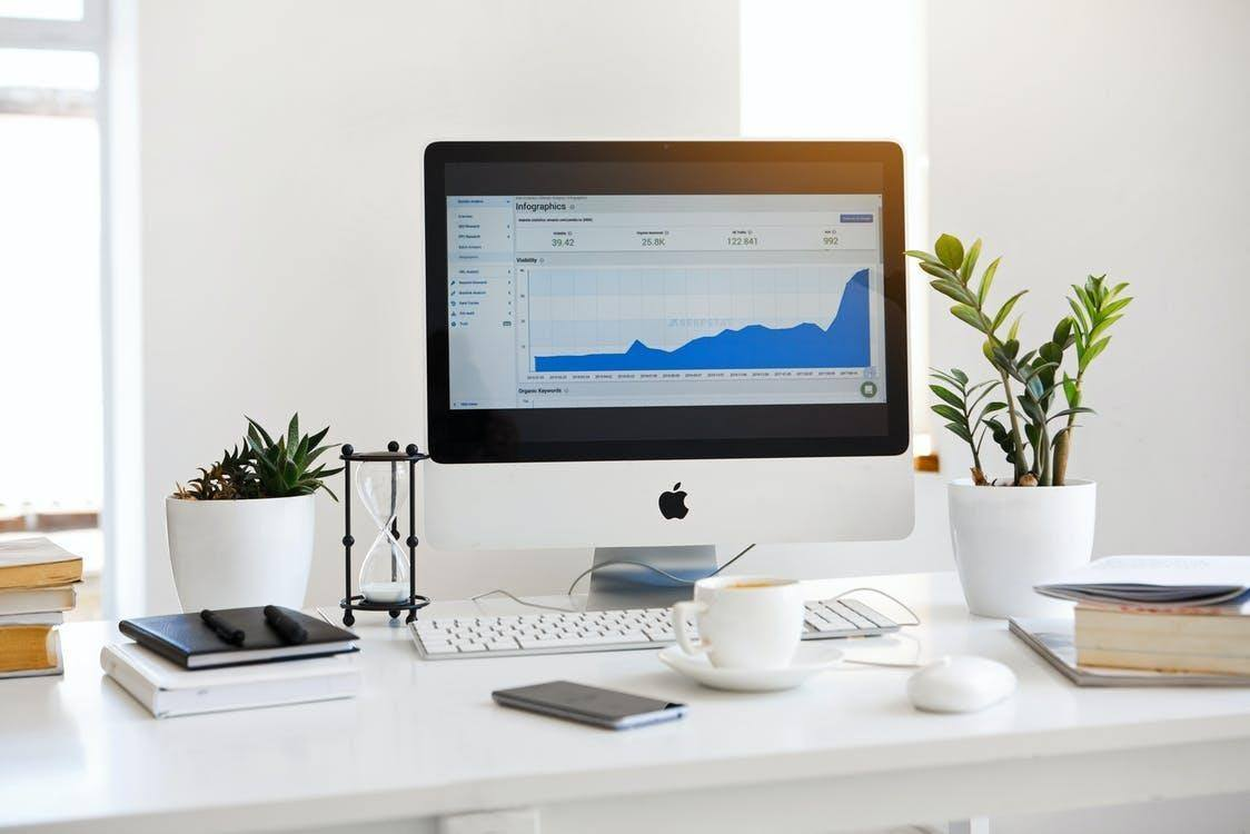 Silver Imac Displaying Line Graph Placed on Desk increase your online sales fast