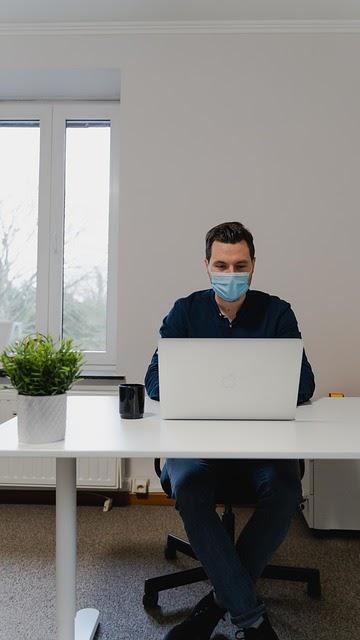 man-laptop-mask-desk-work-office global pandemic