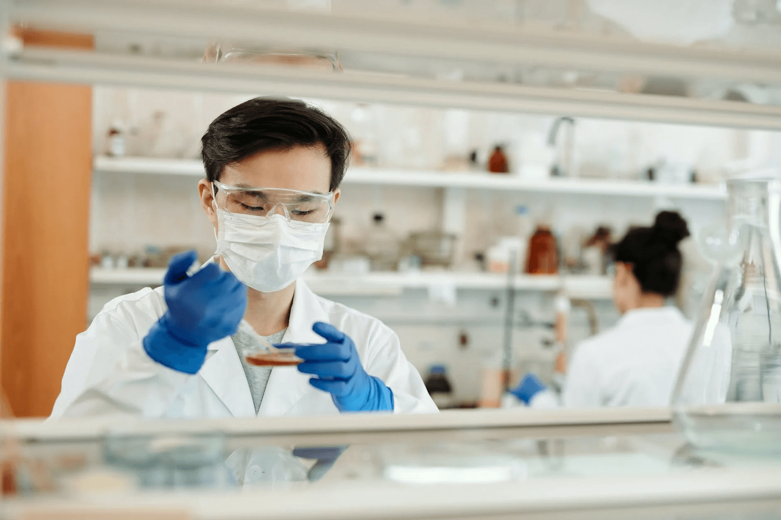 man-doing-a-sample-test-in-the-laboratory key healthcare jobs