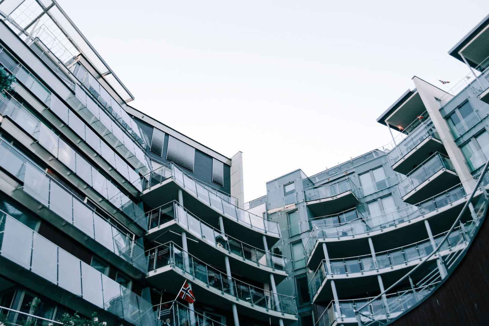 modern-geometric-glass-building-with-balconies prone to water damage remediation