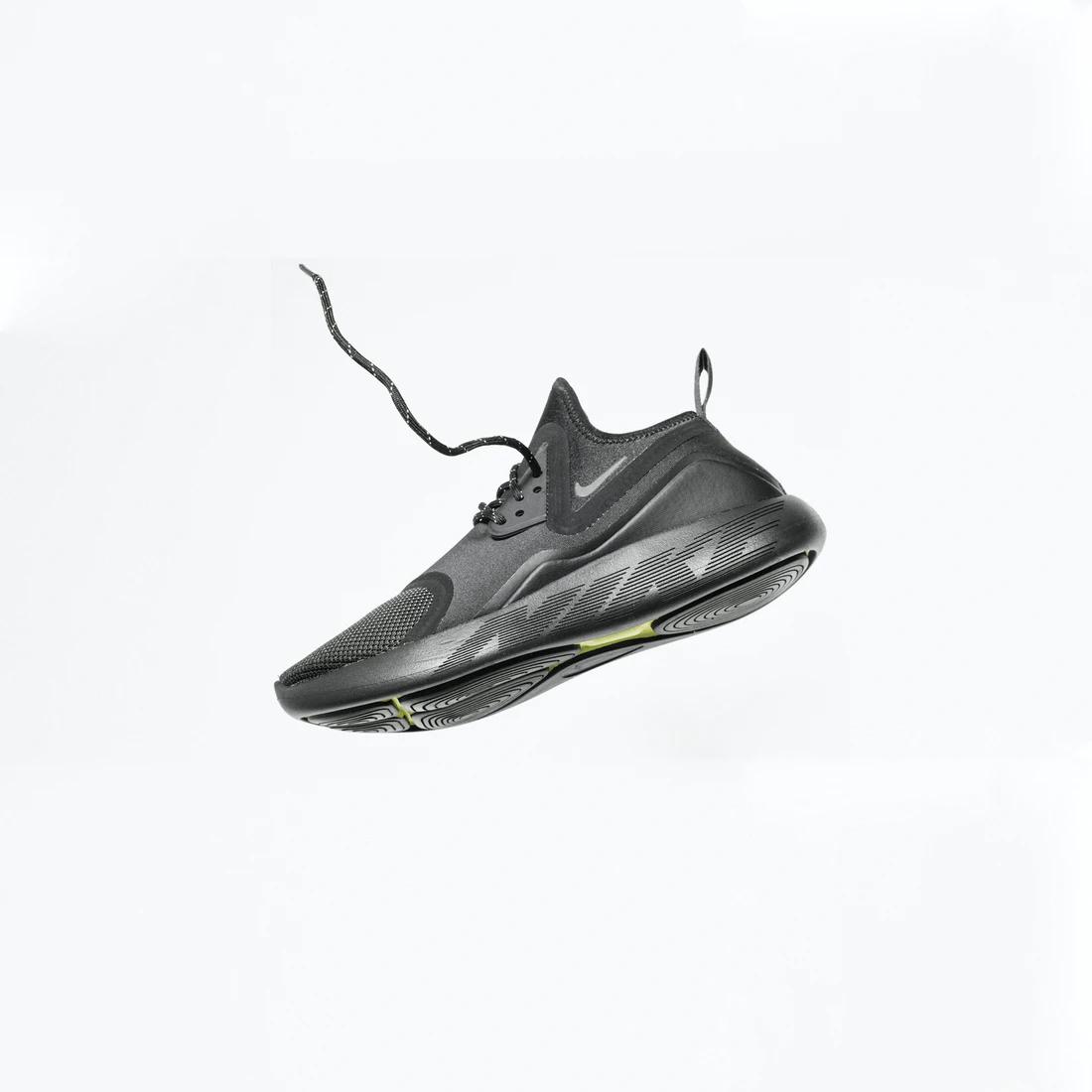 black foot of nike brand sneakers