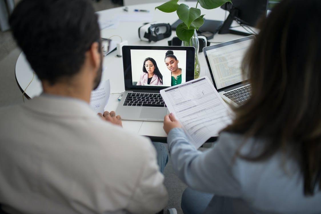Woman in White Long Sleeve Shirt Using Macbook Pro online reputation