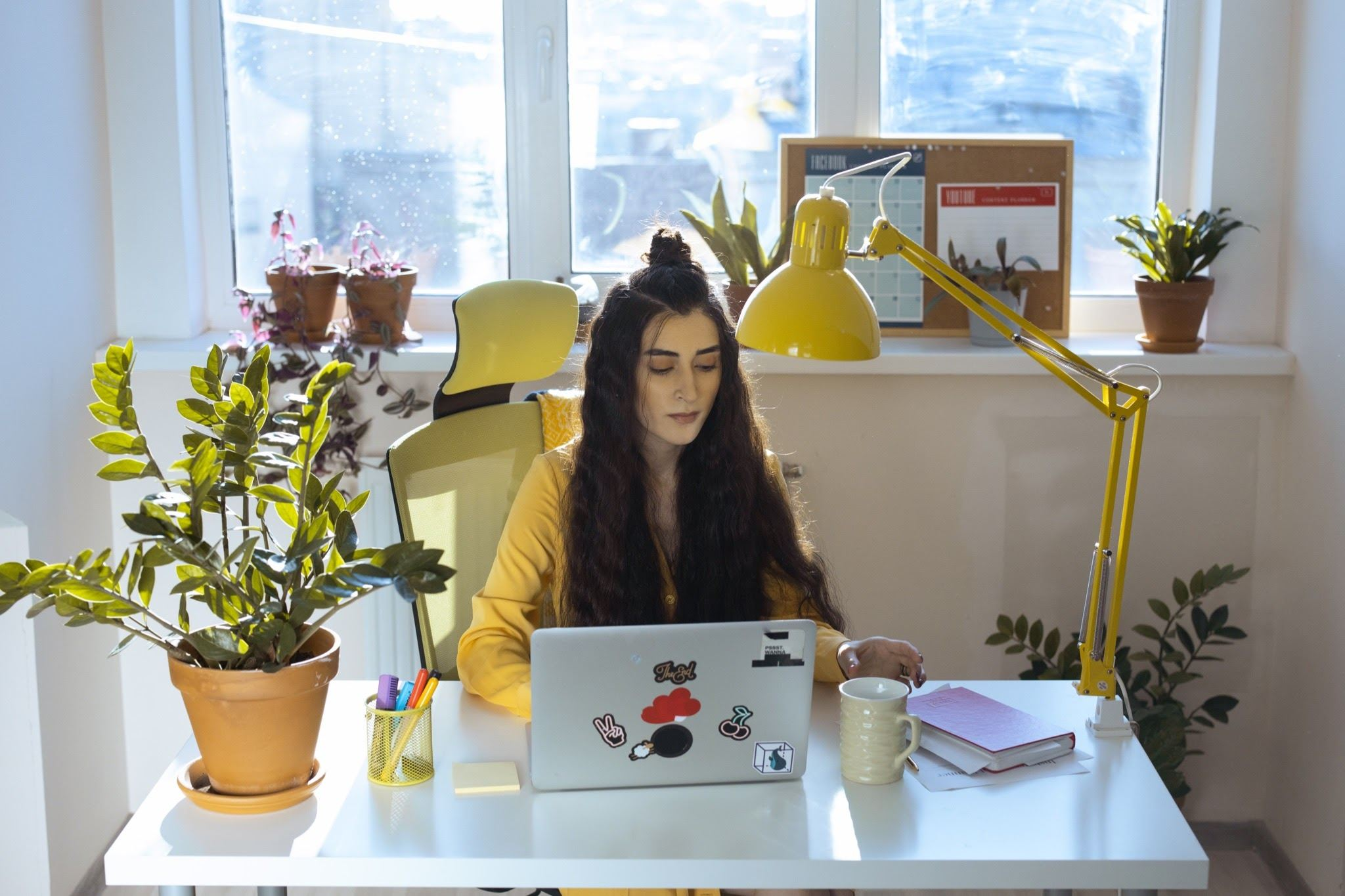 woman working at open laptop Tips For Working From Home