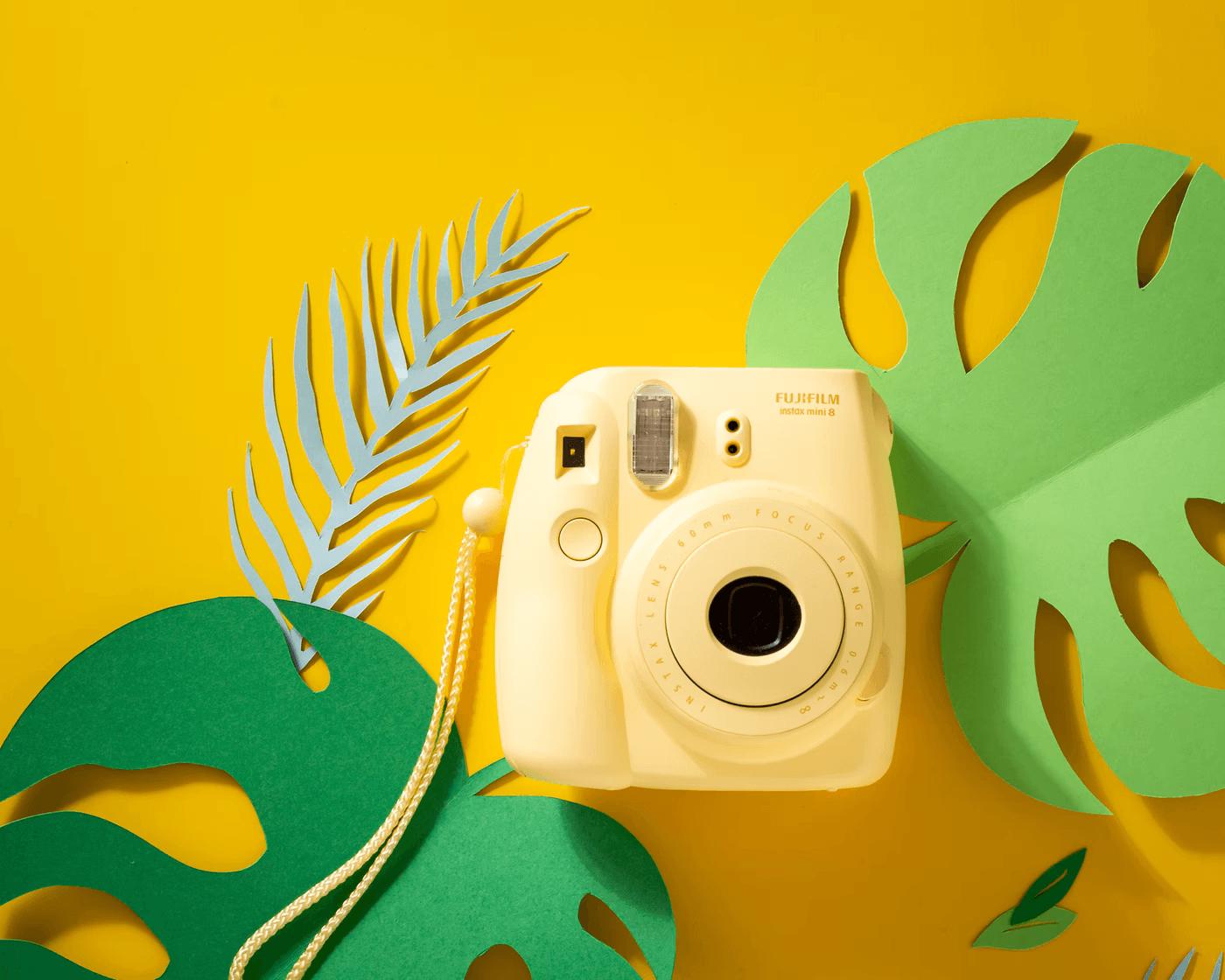 yellow camera om yellow background product idea